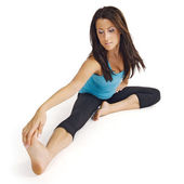 Stretching her hamstring — Stock Photo