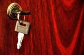 Key in the lock — Stockfoto