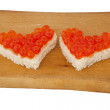 Two pieces of bread in the form of a heart and red caviar — Foto Stock