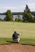 Golfer lines up his Putt — Stock Photo