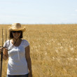 Girl in grain field — Stock Photo