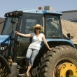 Woman Posing on a Tractor — Stock Photo