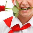 Man with rose in mouth — Stock Photo