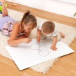 Children drawing in room - Stock Photo