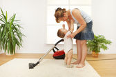 Mother cleaning the floor — Stock Photo