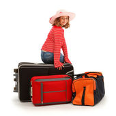 Girl sitting on luggage — Stock Photo