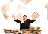 Man throwing away paperwork — Stock Photo