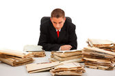 Man looking at lots of documents — Stockfoto