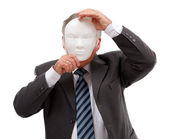 Man covering his face with mask — Stock Photo