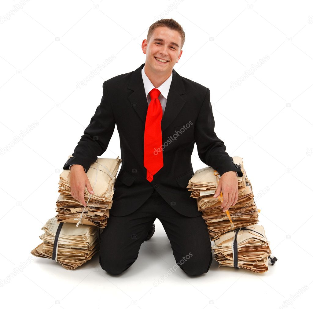 Happy business man felt on knees, with lots of finished paperwork — Stock Photo #4012011