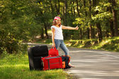 Young hitch-hiker girl — Stock Photo