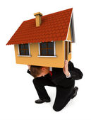 Business man holding house on his back — Stock Photo
