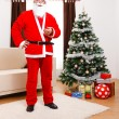 Santa Claus standing in front of Christmas Tree — Stock Photo