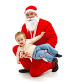 Santa Claus with little boy — Stock Photo