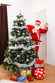 Santa Claus looking back and greeting — Stock Photo