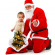 Santa claus and little boy looking at us — Stock Photo #4482798