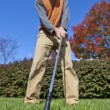Addressing the ball on the fairway - Stock Photo
