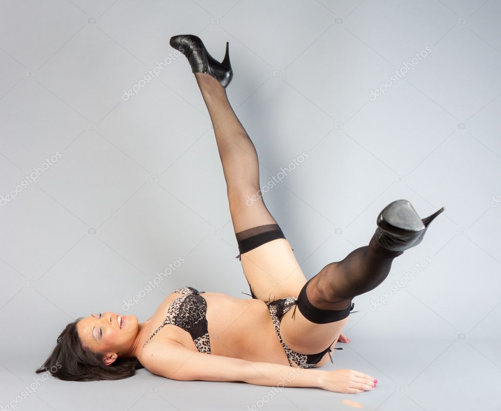 A beautiful African American woman on her back, heels in the air — Stock Photo #4700005