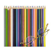 Colored pencils with glasses — Zdjęcie stockowe
