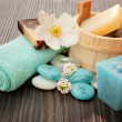 Spa setting with flower and blue candle — Stock Photo
