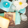 Spa setting with flower and blue candle — Stockfoto