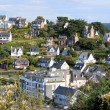 Nice coastal village in sunshine - colored houses on a hill - Stok fotoğraf
