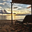 Sunset in Phu Quoc close to Duong Dong with sun bed, South ChinSea, Vietn — Stock Photo #4223228