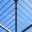 Symmetric (triangle) roof made of steel with lights and shadows — Stock Photo