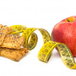 Red apple, cookies and measured metre on white background — Foto Stock #4295182