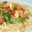 Sausage and Shrimp over Pasta — Stock Photo #3936801