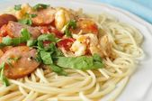 Sausage and Shrimp over Pasta — Stock Photo