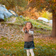 The girl is pulling back tree branch — Stok fotoğraf