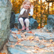 Smiling girl in autumn park — Stok fotoğraf
