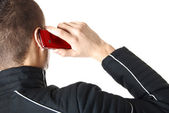 Man is talking on red smart phone | Isolated — Stock Photo