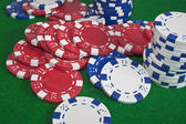 Red, blue and white poker chips — Stock Photo
