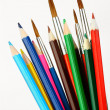 Colored pencils and brushes — Stock Photo