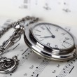 Old clocks and music books - Stockfoto