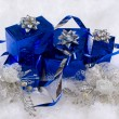 Blue boxes and Christmas decoratoins on the white skin — Stock Photo #4001582