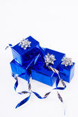 Many blue shiny boxes for gifts with ribbons and tapes — Stock Photo