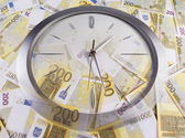 A clock and 200 euro banknotes on a white background — Stock Photo