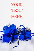 Blue shiny boxes for gifts with ribbons on the white skin — Stock Photo