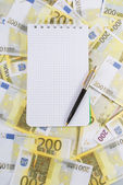 Writing-book for notes with pen on banknotes 200 euros — Стоковое фото