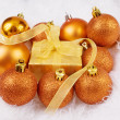 Christmas spheres and box on the white fur — Stock Photo
