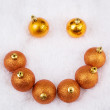Stock Photo: Christmas brightly golden spheres on white fur