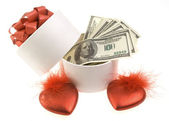 White round box with dollars and two red hearts — Stock Photo