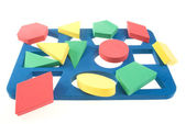 Children's developing game with color geometric shapes — Stock Photo