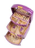 Lilac box with golden jewelry — Stockfoto