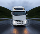 Motion of white truck on the night road — Stock Photo