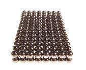 Rectangle of shiny metallic balls — Stock Photo
