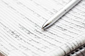 Silver pen on a notebook — Stock Photo